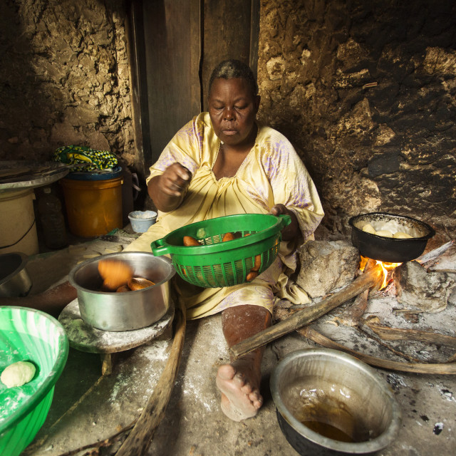 """ZANZIBAR, TANZANIA - MAY 1: Unidentified woman cooking donuts inside of..."" stock image"