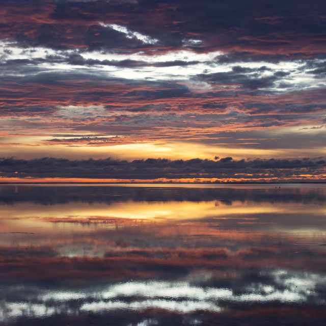 """""""Early morning, sunrise over sea with beautiful and colorful clouds and..."""" stock image"""