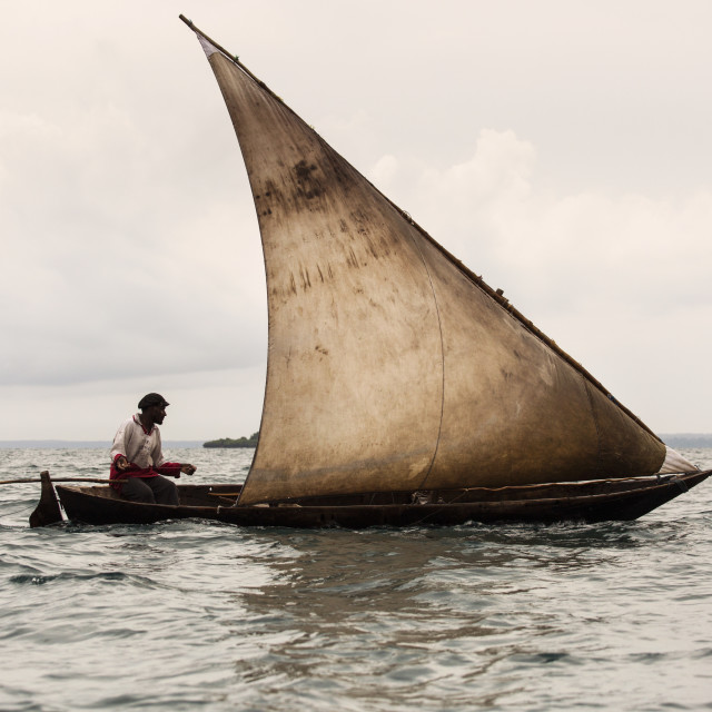 """Editorial use only. Unkwon man fishing on his boat. People in Africa face..."" stock image"