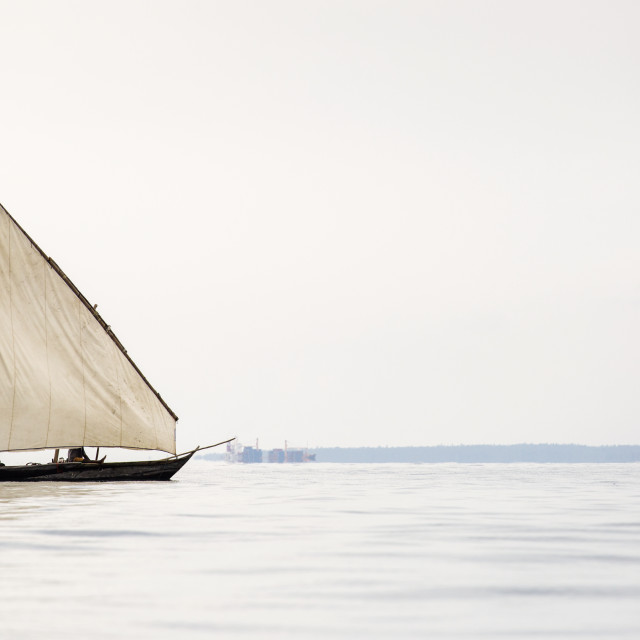 """Traditional fisherman boat in Zanzibar on ocean with rainy clouds."" stock image"
