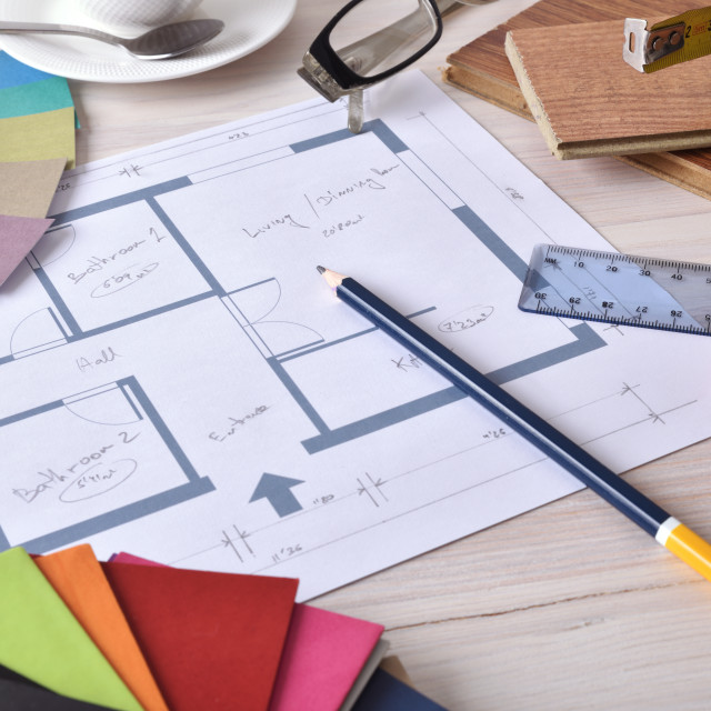 """""""Decorator workbench with home plan on wooden table elevated"""" stock image"""