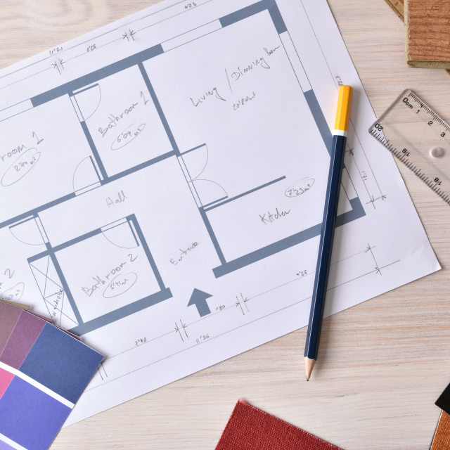 """""""Decorator workbench with home plan on wooden table top"""" stock image"""