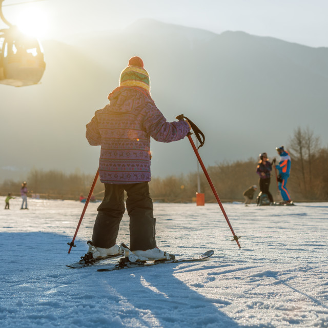 """Little boy skiing down the hill"" stock image"