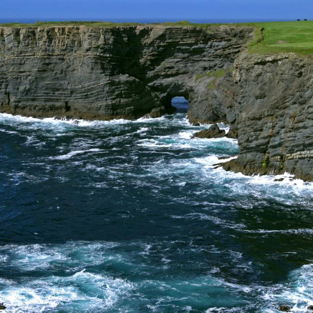 """Coastal Arch at Kilkee Cliffs Republic of Ireland"" stock image"