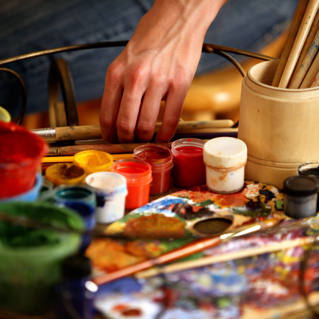 """""""Artist painting easel studio. Cropped shot hands paints with brush."""" stock image"""