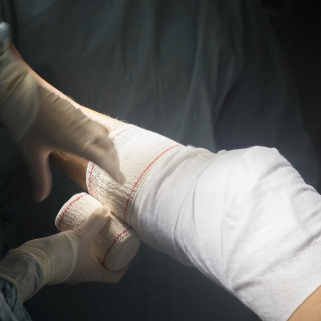 """Knee surgery nurse bandaging"" stock image"