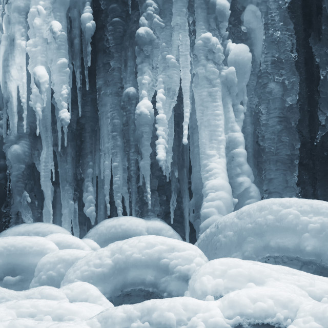 """icicles on frozen waterfall in winter background"" stock image"