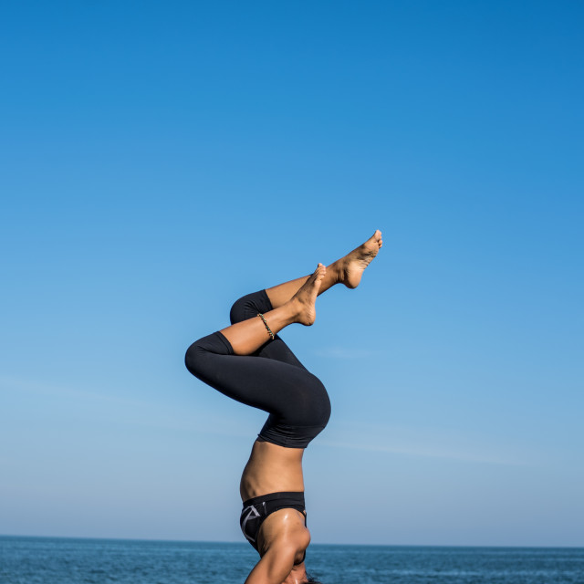 """Asian woman yoga on the beach"" stock image"
