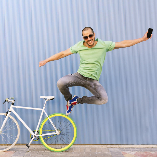 """Outdoor portrait of handsome jumping."" stock image"
