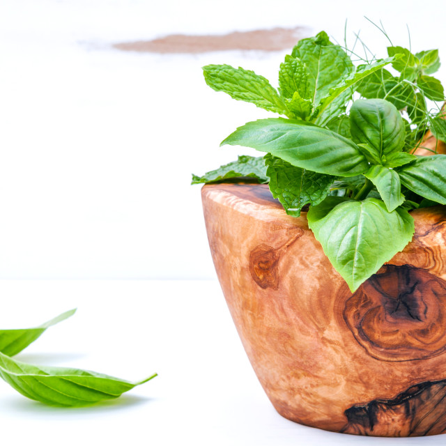"""""""Alternative medicine fresh herbs in the wooden mortar . Food ingredients and..."""" stock image"""