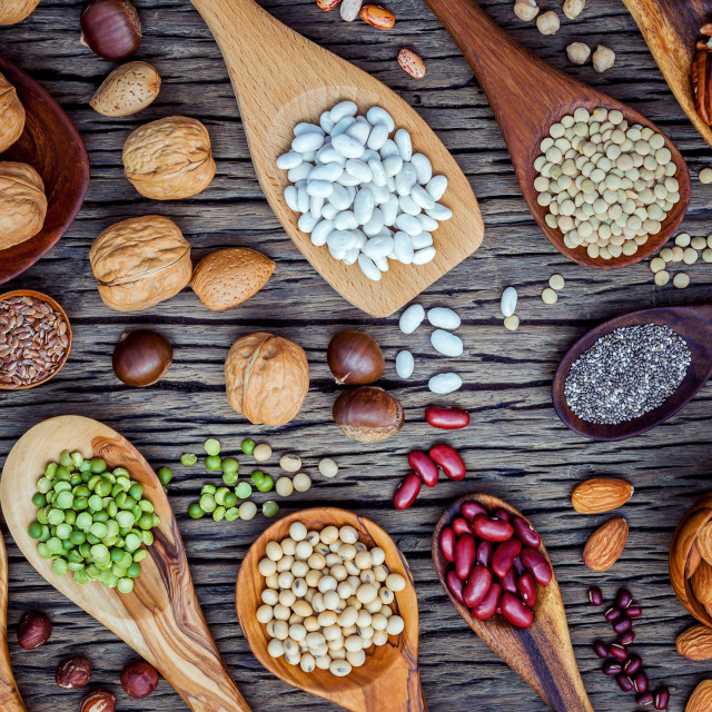 """""""Various legumes and different kinds of nutshells in spoons. Walnuts kernels..."""" stock image"""