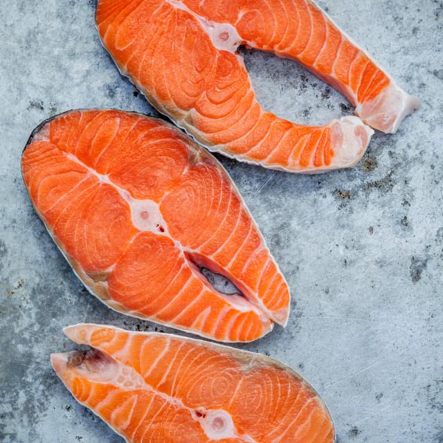 """Fresh salmon fillet sliced flat lay on shabby metal background. Fresh salmon..."" stock image"
