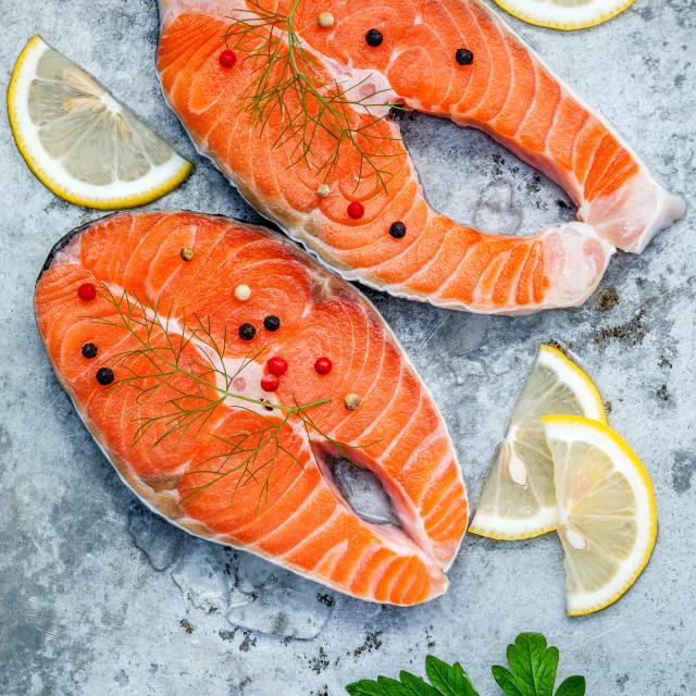"""Fresh salmon fillet sliced flat lay on shabby metal background. Raw salmon..."" stock image"