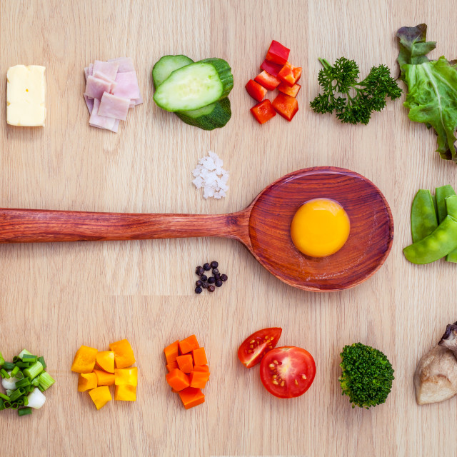 """""""Ingredients of homemade omelet on wooden panel.Various vegetable and..."""" stock image"""