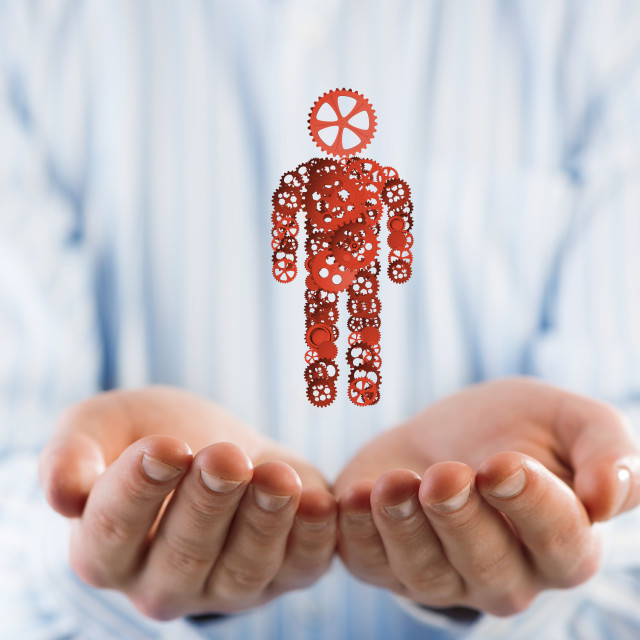 """""""Businessman palm showing figure made of gear mechanism as symbol for self..."""" stock image"""