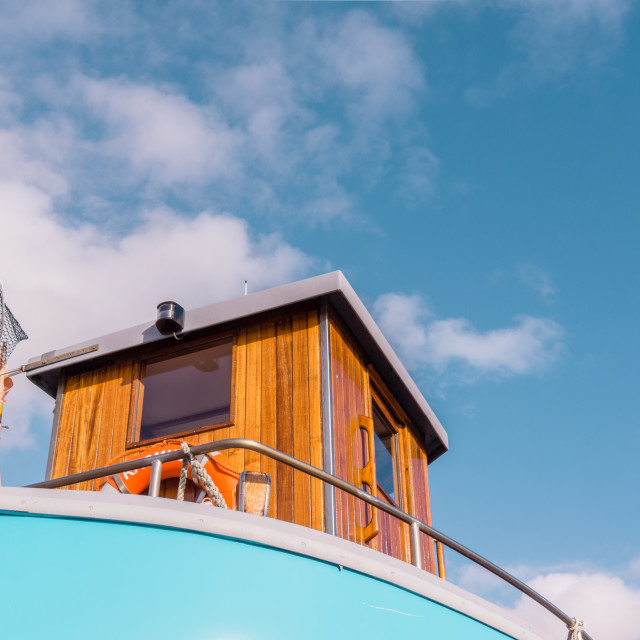 """""""Trawler with cabin against blue sky"""" stock image"""