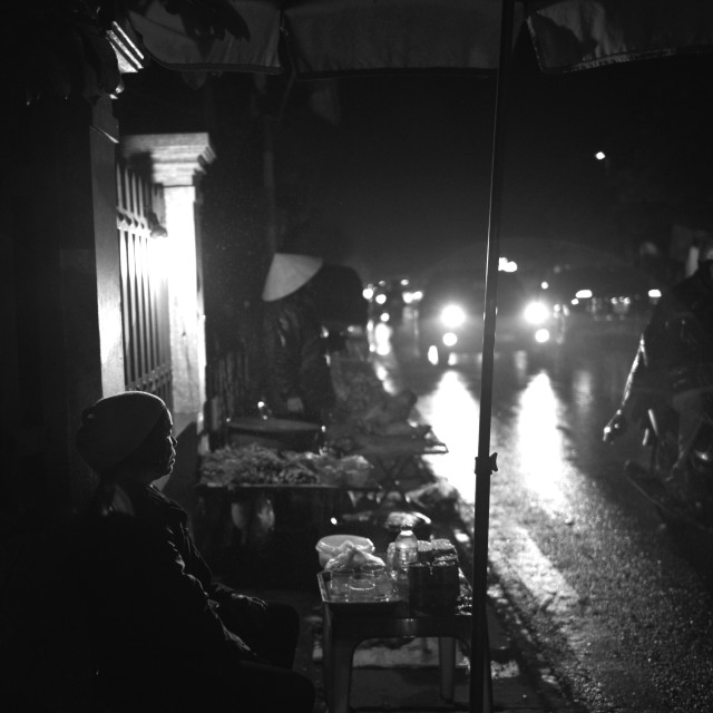 """""""A street vendor - midnight in Nam Dinh"""" stock image"""