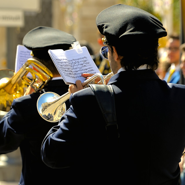 """""""Detail of a musician plays the trumpet reading the score (shallow focus)."""" stock image"""