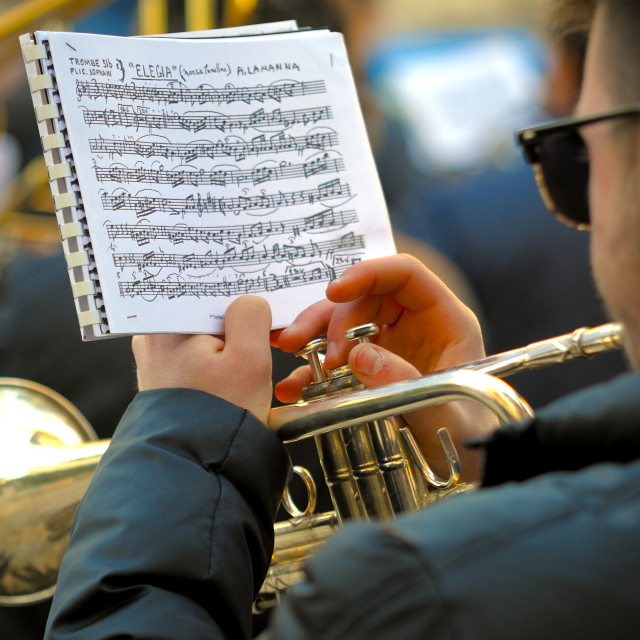 """Detail of a musician plays the trumpet reading the score"" stock image"