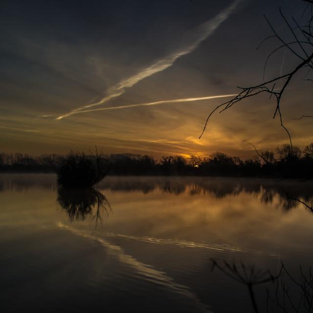 """Sunrise over a lake."" stock image"