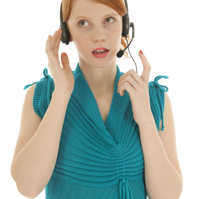"""""""Young red haired woman with head set"""" stock image"""
