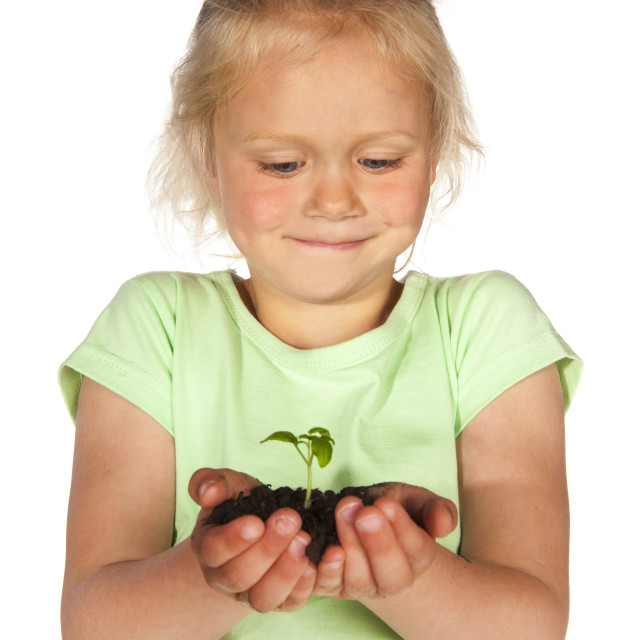 """""""Portrait little blond girl with growing nature"""" stock image"""