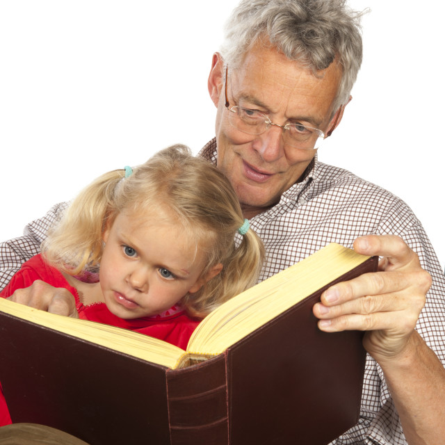 """Grand-father read to his grand-child"" stock image"