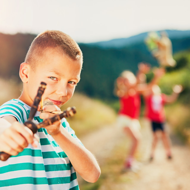"""Boy with slingshot"" stock image"