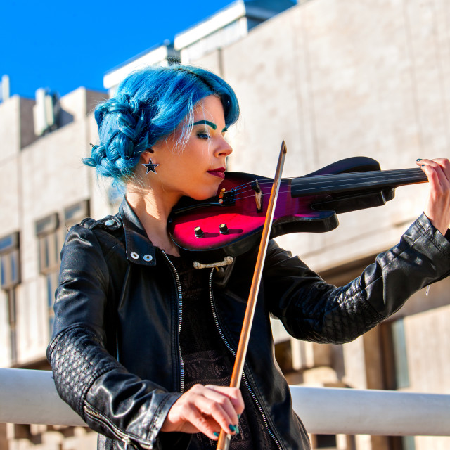 """Woman perform music on violin park outdoor. Girl performing jazz ."" stock image"