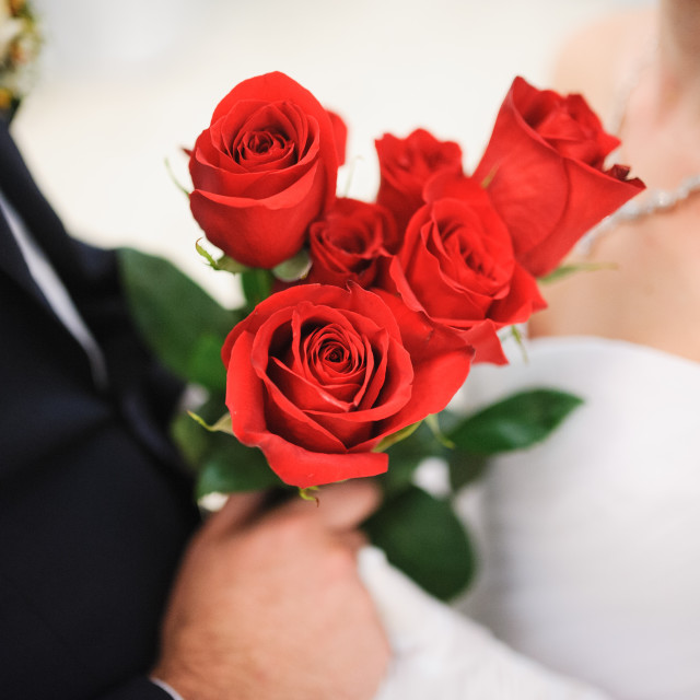 """A bride and groom with flowers roses"" stock image"