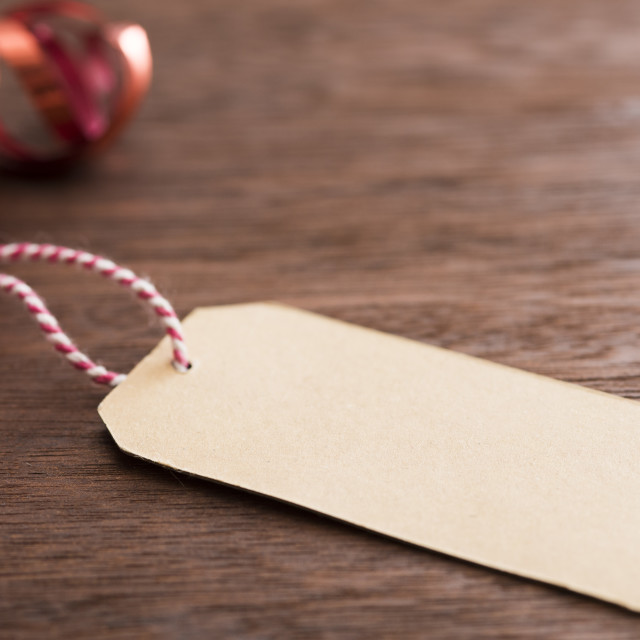 """Paper label near christmas baubles"" stock image"