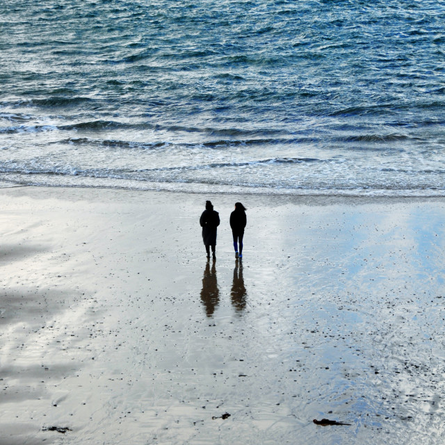 """Couple walking in St Ives Bay"" stock image"