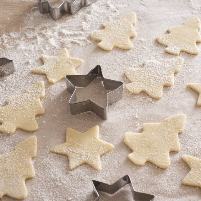 """Baking festive tree and star christmas cookies"" stock image"