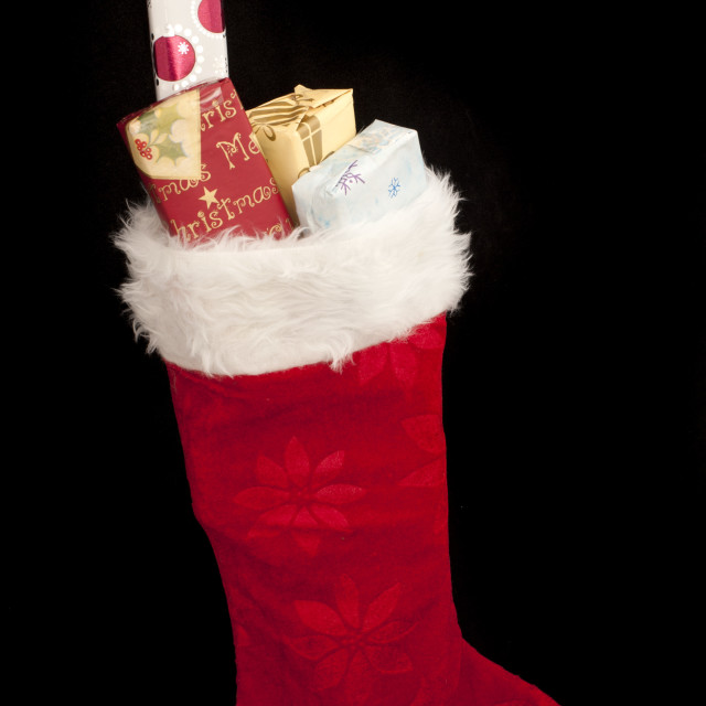 """Standing stocking with presents"" stock image"