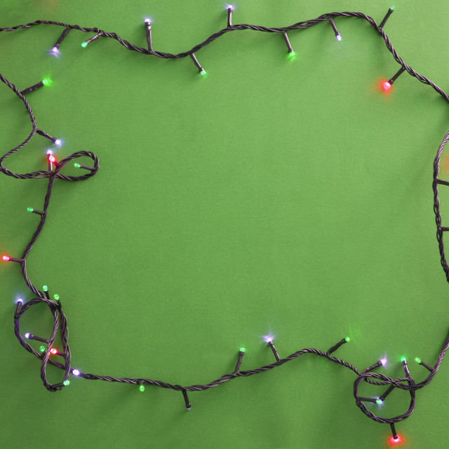 """Festive garland on green background"" stock image"