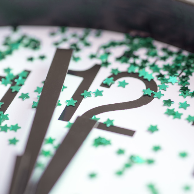 """Midnight on a clock decorated with green stars"" stock image"