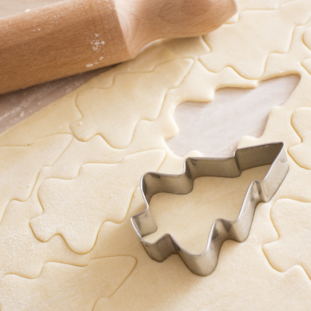 """Making Christmas tree cookies"" stock image"