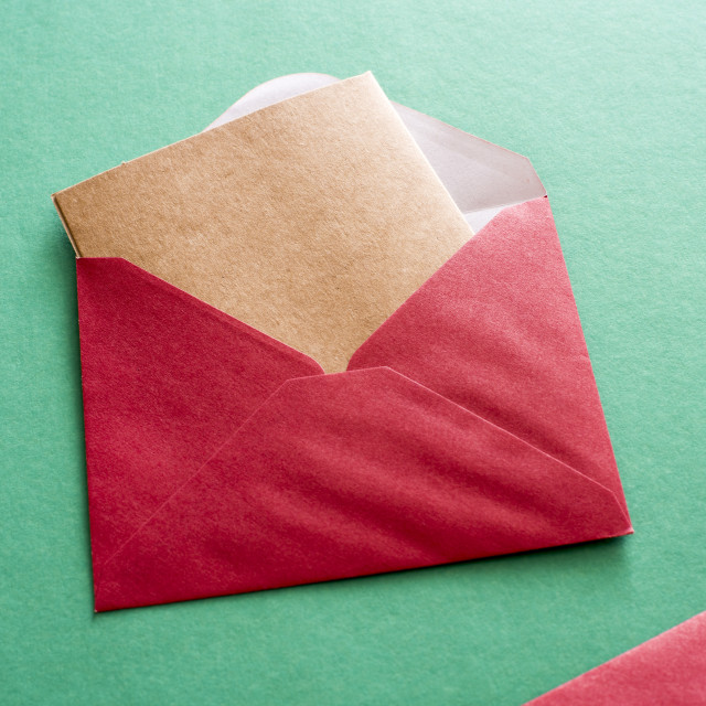 """Blank brown card in a red Christmas envelope"" stock image"