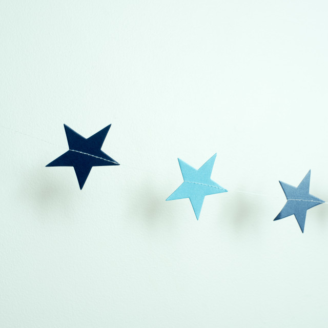"""Diagonal string of blue paper stars"" stock image"