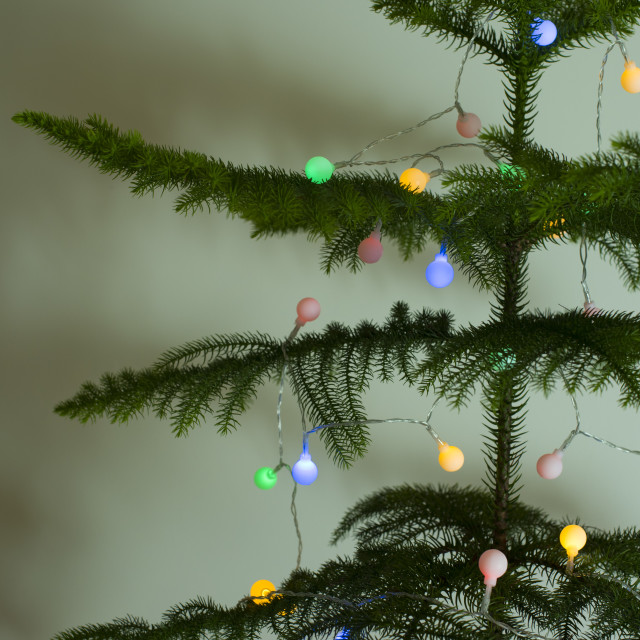 """Colorful lights on a natural Christmas tree"" stock image"