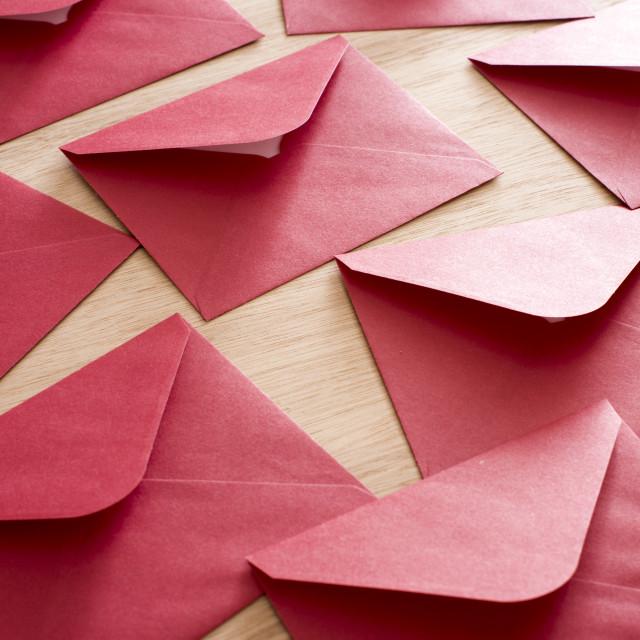 """Festive red Christmas envelopes background"" stock image"