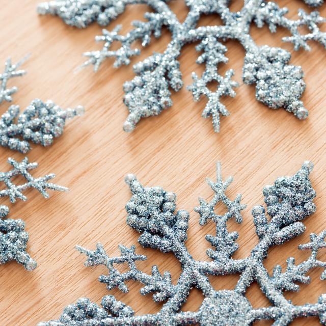 """Tasteful ornamental glitter snowflake decorations"" stock image"