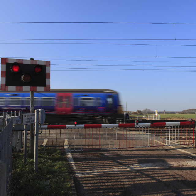"""Speeding Train Overhead Live Wires Danger Sign at unmanned level crossing..."" stock image"