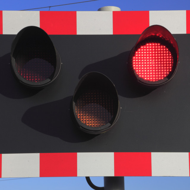 """Red Warning light at an unmanned Level crossing, East Coast Main Line..."" stock image"