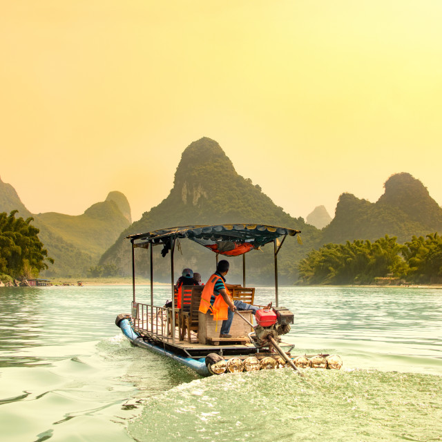 """Tourists cruising Li River in Yangshuo, China"" stock image"
