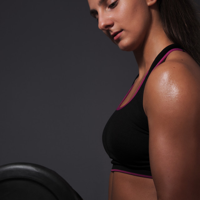 """""""Sporty Woman Doing Biceps Exercise"""" stock image"""