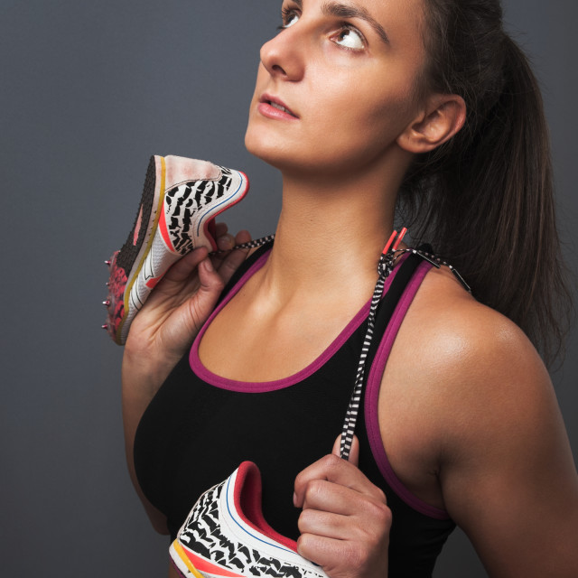 """""""Sporty Woman Posing with Sprinter Shoes"""" stock image"""