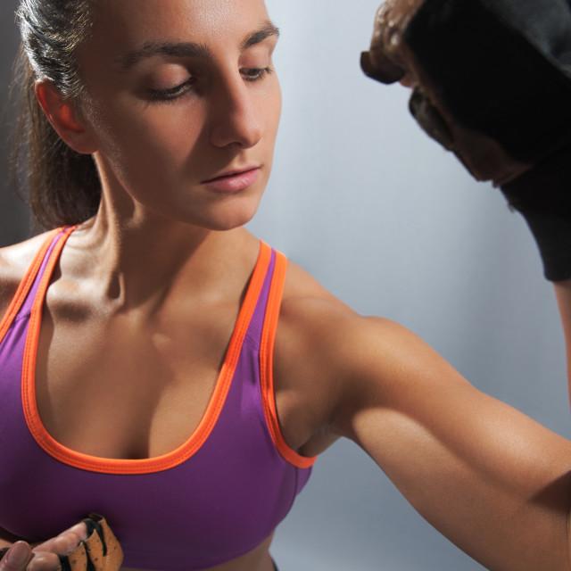 """Sporty Woman Flexing Biceps"" stock image"