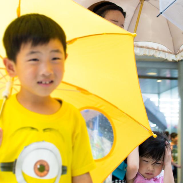 """I want my own umbrella!"" stock image"