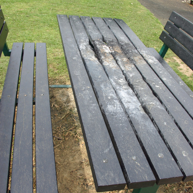 """Vandalised picnic bench"" stock image"